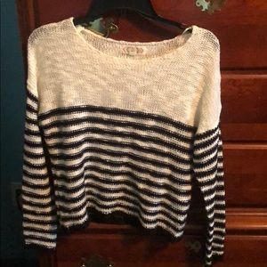 Knitted long sleeved black and white sweater